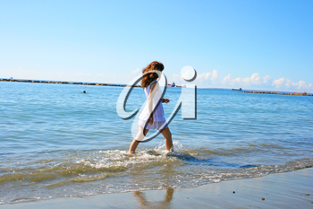 Royalty Free Photo of a Woman Walking on the Beach