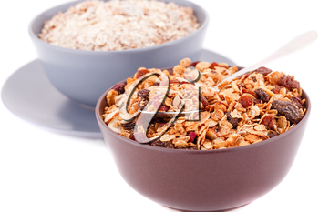 Muesli in the bowls isolated on white background.