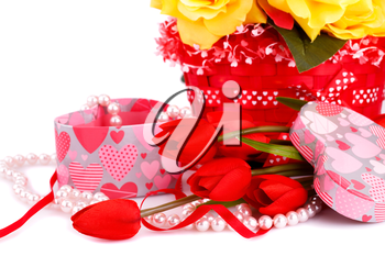 Colorful flowers, candles and gift box close up picture.