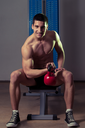 Young Man Exercise With Kettle Bell Biceps