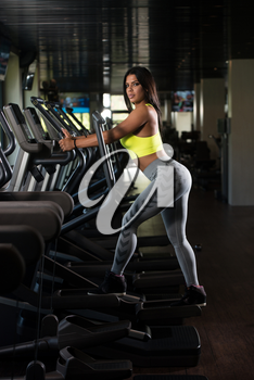 Fitness Girl Exercising On Moonwalker Treadmill Gym Equipment