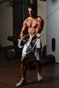 Young Man Is Working On His Chest With Cable Crossover In A Modern Fitness Gym