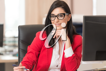 Portrait Of A Young Business Woman Using A Computer In The Office