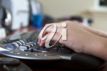 Girl typing on ergonomic wireless keyboard