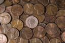 one cent pieces with rare Indian Head Cent in middle of pile