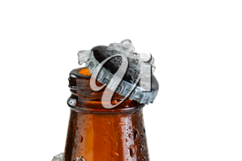 Close up view of a beer bottle neck, with cap off, covered with ice and condensation. Layout in horizontal format isolated on white. Focus on bottle cap with shallow depth of field.