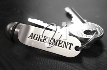Agreement Concept. Keys with Keyring on Black Wooden Table. Closeup View, Selective Focus, 3D Render. Black and White Image.