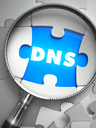 DNS - Puzzle with Missing Piece through Loupe. 3d Illustration with Selective Focus.