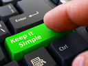 Person Click on Green Keyboard Button with Text Keep It Simple. Selective Focus. Closeup View.