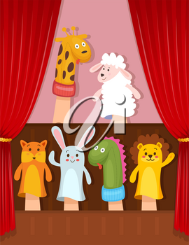 Set of hand animal puppets acting on the stage
