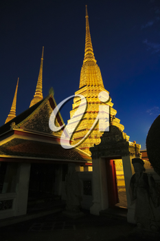 Buddhist pagodas of Wat Pho temple in Bangkok, Thailand. It is 42 meters high and decorated with color-glazed tiles.