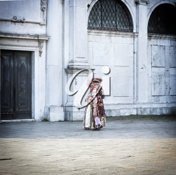 people in carnival costume on place of Venice, Italy 2019