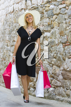 A stunningly beautiful wealthy young blond woman shopping in Europe with plenty of style