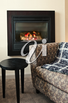 Fireplace and cozy armchair in living room