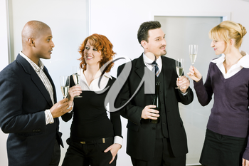 People at a reception at the point where the toast is being given, maybe an office party - people wearing business clothes