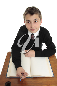 Young high school student looking up with open book at desk.