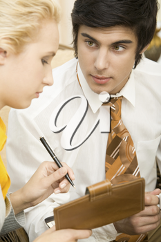 Portrait of confident businessman looking at his partner during explanation