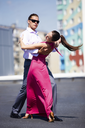Portrait of attractive couple dancing together outdoor