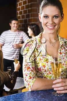 Portrait of smiling girl  with alcoholic drink in a night club