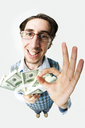 Wide angle of young man with dollars showing sign of okay and looking at camera