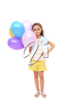 Portrait of happy girl with colorful balloons on white background