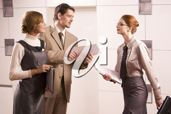 Photo of attractive business people looking at smart woman while man giving her document