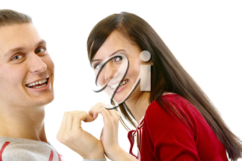 Portrait of attractive girl and her boyfriend looking at camera while making shape of heart by their hands