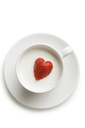 Over view of red ripe strawberry inside cup of milk