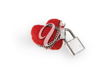 Image of red toy heart held over by chain on white background