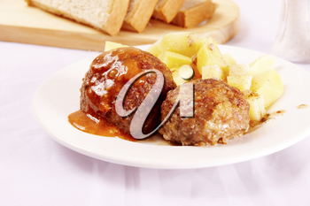 Image of several raw cutlets meat with flour