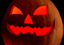 Close-up of grinning pumpkin with red backlight