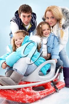 Happy family members in winter clothes looking at camera