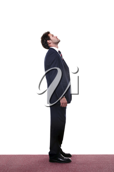 Full length shot of a businessman looking up high.