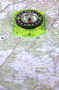 Compass on a map, shallow DOF, focus on compass.