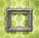 Royalty Free Photo of a Silver Picture Frame on a Green Wall