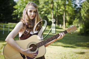 A portrait of a caucasian girl with her guitar