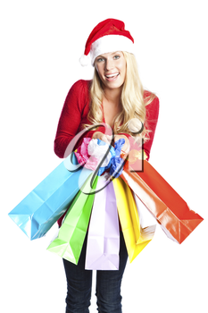 A portrait of a beautiful caucasian christmas santa girl carrying shopping bags