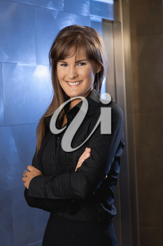 Portrait of happy young businesswoman, smiling.