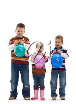 Happy children wearing jeans and striped t-shirt, holding colorful toy balloons, laughing. Isolated on white background.