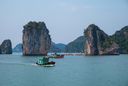 Rocky islands and boats in Halong Bay, Vietnam, Southeast Asia