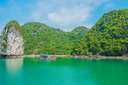 Floating house and rock island in Halong Bay, Vietnam, Southeast Asia