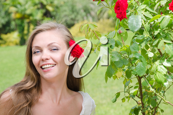 beautiful happy woman among the flowers
