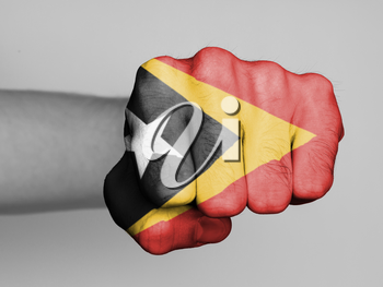 Fist of a man punching, flag of East Timor