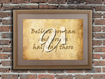 Old wooden frame with written text on an old wall - Believe you can