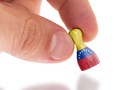 Hand holding wooden pawn with a flag painting, selective focus, Venezuela
