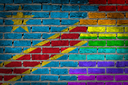 Dark brick wall texture - coutry flag and rainbow flag painted on wall - Congo