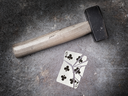 Hammer with a broken card, vintage look, six of clubs