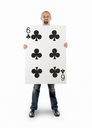 Businessman with large playing card - Six of clubs