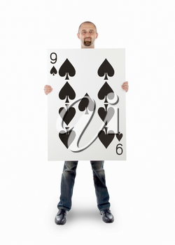 Businessman with large playing card - Nine of spades