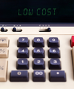 Old calculator showing a text on display - low cost